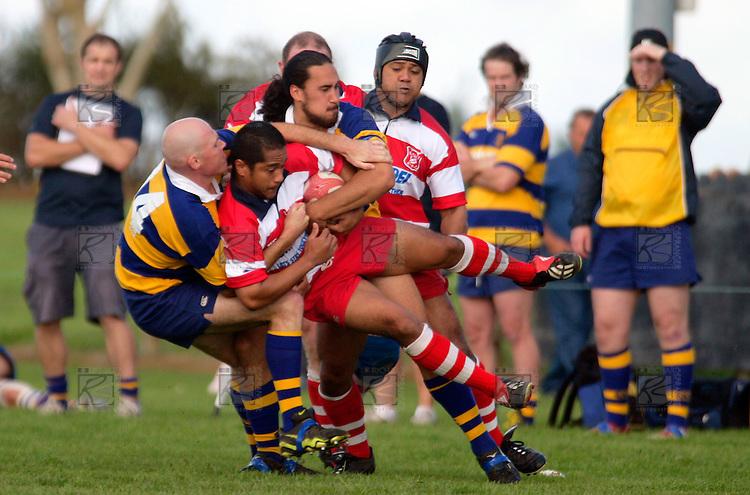P. Wheeler & A. Poa take Karaka's S. Fungawaka .Counties Manukau Premier Club Rugby, Patumahoe vs Karaka played at Patumahoe on Saturday 22nd April 2006. Karaka won 19 - 6.