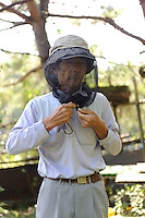 Beekeeper Masahiro Tominaga, Inadani, Nagano Pref, Japan, September 24, 2011.  Inadani is home to Japanese honey-bee farms. The bees feed off red-soba flowers and the exceptionally high-quality honey they produce is sold at a premium.