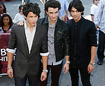 UNIVERSAL CITY, CA. - September 14: Musicians Nick Jonas, Kevin Jonas and Joe Jonas of The Jonas Brothers arrive at The City of Hope Benefit Concert at Gibson Amphitheater on September 14, 2008 in Universal City, California.