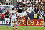 07 December 2014: New England's Jermaine Jones (13) and Los Angeles's Alan Gordon (right) challenge for a header. The Los Angeles Galaxy played the New England Revolution in Carson, California in MLS Cup 2014. Los Angeles won 2-1 in overtime.