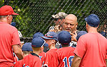 WATERBURY, CT-0712217JS05--Wolcott coach Dave Pelliter talks to his team between innings of their Roberto Clemente Tournament game against the BC Cyclones Saturday at Municipal Stadium in Waterbury. <br /> Jim Shannon Republican-American