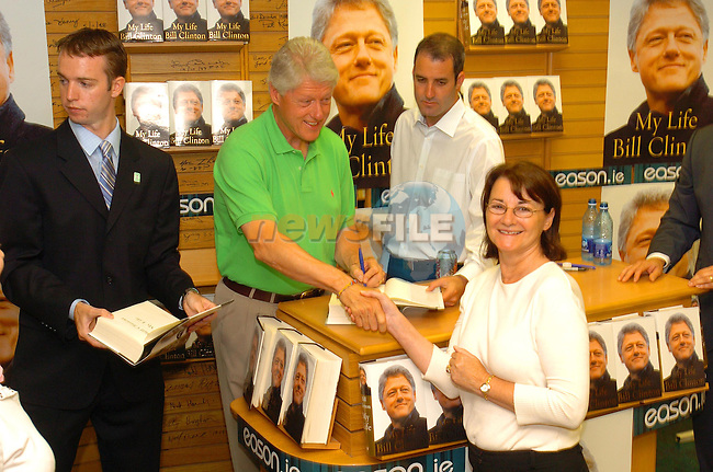 Betty McCloskey shaking hands with former American president Bill Clinton at his book signing in Easons in dublin...Photo Fran Caffrey Newsfile.ie..This Picture has been sent to you by Newsfile Ltd..The Studio,.Millmount Abbey,.Drogheda,.Co. Meath,.Ireland..Tel: +353(0)41-9871240.Fax: +353(0)41-9871260.ISDN: +353(0)41-9871010.www.newsfile.ie..general email: pictures@newsfile.ie
