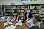 Heasun Kim, director of the United Methodist Women-sponsored Scranton Women's Leadership Center in Seoul, South Korea, visits with a group of students at Harris Memorial College in Manila, Philippines, on January 16, 2018.  Kim was in the Philippines with other UMW staff to meet with women from throughout the region, and visit UMW-supported mission institutions.