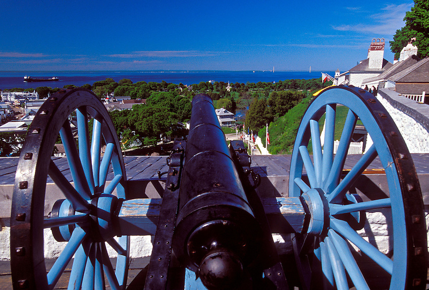 A CANON LOOKS OUT FROM ATOP FORT MACKINAC ON MACKINAC ISLAND, MICHIGAN.