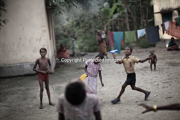 Young children from the Chowduli class seen playing outside their local school in Chaymalpur village of North 24 Parganas in West Bengal, India. Photo: Sanjit Das/Panos for The Wall Street Journal. Slug: ICASTE