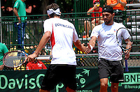 CALI – COLOMBIA – 05-04-2014: Victor Estrella y Jose Hernandez de Republica Dominicana celebran el punto contra Juan Sebastian Cabal y Robert Farah de Colombia durante el dia dos de partidos en el Grupo I de la Zona Americana de la Copa Davis, partidos entre Colombia y República Dominicana en Estadio de Tenis Alvaro Carlos Jordan en la ciudad de Cali. / Victor Estrella and Jose Hernandez of the Dominican Republic celebrate a point against Juan Sebastian Cabal and Robert Farah of Colombia during day two in matches for the Group I of the American Zone Davis Cup, between Colombia and the Dominican Republic, at the Carlos Alvaro Jordan, Tennis  Stadium in the city of Cali. Photo: VizzorImage / Luis Ramirez / Staff.