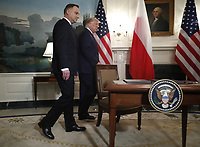 US President Donald J. Trump (R) and Polish President Andrzej Duda (L) arrive to participate in a signing ceremony in the Diplomatic Reception Room of the White House in Washington, DC, USA, 12 June 2019. President Trump and President Duda signed an agreement to increase military to military cooperation including the purchase of F-35 fighter jets by Poland and an increased US troop presence in Poland. <br /> Credit: Shawn Thew / Pool via CNP/AdMedia