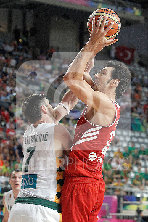 Lithuania's Darjus Lavrinovic (l) and Turkey's Kerem Gonlum during 2014 FIBA Basketball World Cup Quarter-Finals match.September 9,2014.(ALTERPHOTOS/Acero)