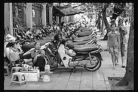 Vietnamese enjoy a quiet afternoon in the old section of Hanoi, Vietnam, June 2016.