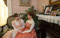 NWA Democrat-Gazette/BEN GOFF @NWABENGOFF<br /> Oryah Rudick (left), in costume as Katherine Peel, and Sarah Goble, in costume as Mary Emaline Berry Peel, both Arkansas Arts Academy students, pose for a photo while preparing for a scene Friday, March 2, 2018, for a project at the Peel Mansion Museum and Heritage Gardens in Bentonville. High school students from the school's audio visual class and theater program are collaborating to produce a 15 minute short film about the Peel Mansion as an entry for the Arkansas Educational Television Network's Student Selects competition for young filmmakers. The film includes interviews with people involved in the museum as well as vignettes of moments in the 1875 home's history with theater students portraying historical figures.