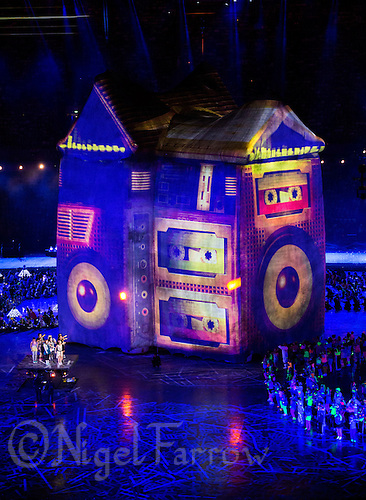 "27 JUL 2012 - LONDON, GBR - Scenes from British TV, films and music videos are projected on a giant house during the ""Frankie and June say...thanks Tim"" section of the Opening Ceremony of the London 2012 Olympic Games in the Olympic Stadium in the Olympic Park, Stratford, London, Great Britain .(PHOTO (C) 2012 NIGEL FARROW)"