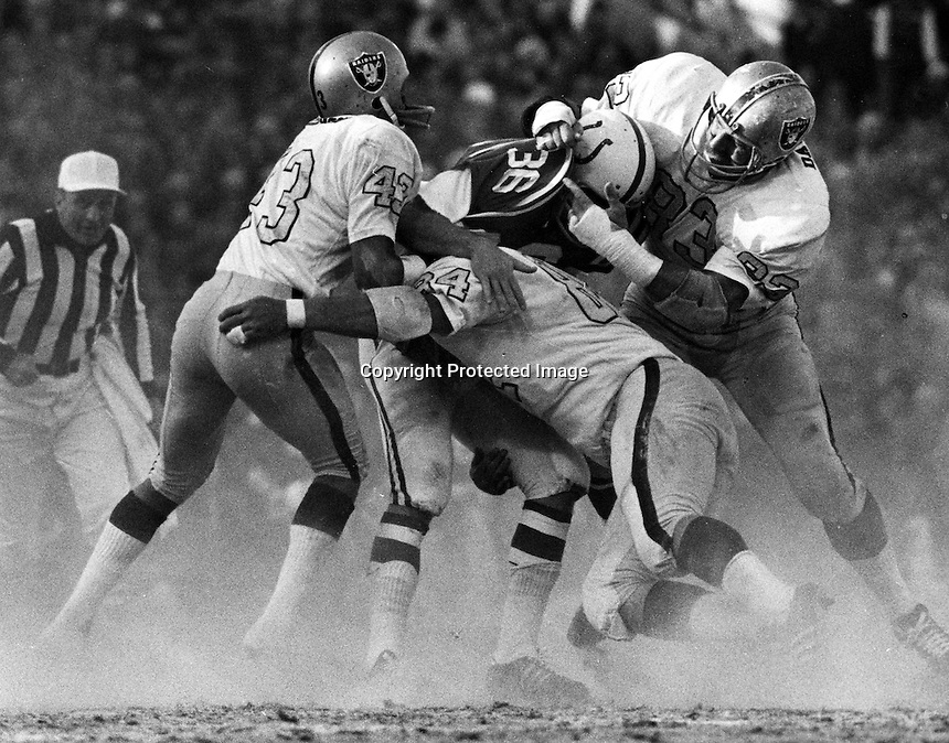 Raider defense combine to stop Colt runner.George Atkinson #43, Tony Cline #84, and Ben Davidson #83. photo by Ron Riesterer