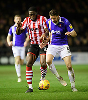 Lincoln City's John Akinde vies for possession with Exeter City's Aaron Martin<br /> <br /> Photographer Chris Vaughan/CameraSport<br /> <br /> The EFL Sky Bet League Two - Lincoln City v Exeter City - Tuesday 26th February 2019 - Sincil Bank - Lincoln<br /> <br /> World Copyright © 2019 CameraSport. All rights reserved. 43 Linden Ave. Countesthorpe. Leicester. England. LE8 5PG - Tel: +44 (0) 116 277 4147 - admin@camerasport.com - www.camerasport.com