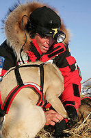 Tuesday March 6, 2007   Paul Gebhart boots his dogs as he readies to leave the Nikolai checkpoint on Tuesday