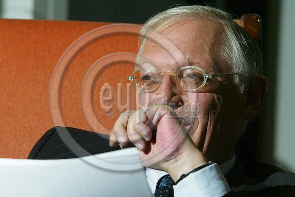 BRUSSELS - BELGIUM - 30 OCTOBER 2006 -- EU Commissioner Günther VERHEUGEN in his office.   PHOTO: ERIK LUNTANG / EUP-IMAGES
