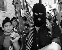 Ramallah, West Bank. Militant gunman pictured during the mock funeral of Wafa Idris, the first Palestinian female suicide bomber.