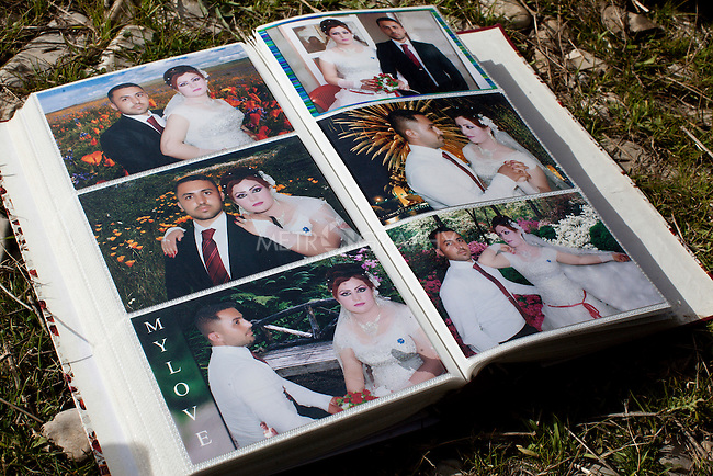 15/02/15 --TANJERO, IRAQ: A photo album of wedding pictures  of Zaydoon and his wife, Hayam.<br /> <br /> Jamal, a Yezidi boy from Sinjar, lives with his displaced family next to an oil refinery in the Kurdish Region of Iraq. He and his cousins run the refinery 24 hours a day with little to no safety equipment. Reporting for this article was supported by a grant from the Pulitzer Center on Crisis Reporting