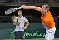 Switserland, Genève, September 16, 2015, Tennis,   Davis Cup, Switserland-Netherlands, Practise Dutch team, Captain Jan Siemerink has his eye on the service of Tim van Rijthoven<br /> Photo: Tennisimages/Henk Koster