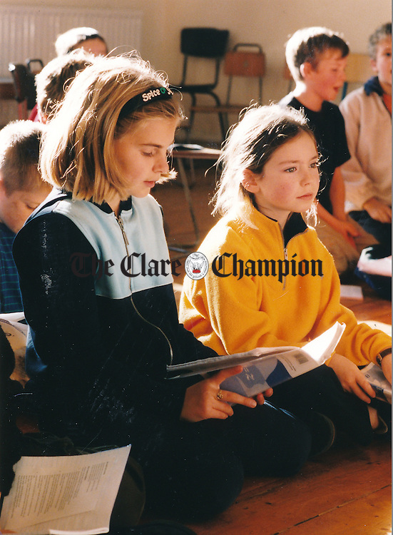 Mary Clune and Siobhan Boyle at singing practice at Knockanean School - October 22, 1999. Photograph by Eamon Ward