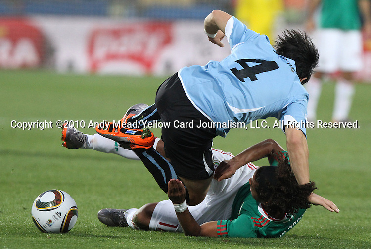 22 JUN 2010: Jorge Fucile (URU) (4) fouls Giovani Dos Santos (MEX) (17). The Mexico National Team lost 1-2 to the Uruguay National Team at Royal Bafokeng Stadium in Rustenburg, South Africa in a 2010 FIFA World Cup Group A match.