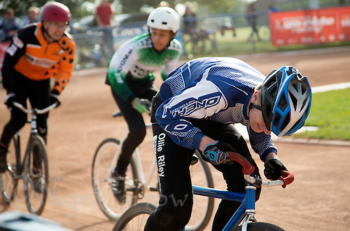 13 SEP 2014 - IPSWICH, GBR - Ollie Riley from Hethersett Hawks pushes himself on during a heat of the Minor Final at the 2014 British Open Club Cycle Speedway Championships at Whitton Sports & Community Centre in Ipswich, Great Britain (PHOTO COPYRIGHT © 2014 NIGEL FARROW, ALL RIGHTS RESERVED)