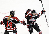 Casey Pickett (Northeastern - 14), Kendall Coyne (Northeastern - 77) - The Boston University Terriers defeated the visiting Northeastern University Huskies 3-2 on Saturday, January 28, 2012, at Agganis Arena in Boston, Massachusetts.