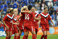 Canada players celebrtae Melissa Tancredi's equalizing goal.