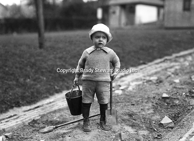Wilkinsburg PA:  Brady Stewart Jr working in the backyard with his father - 1923