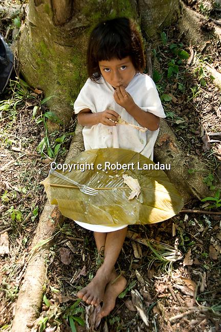 Young Lacandoona girl eats her lunch beneath a tree at Metzabok