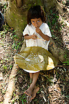 Young Lacandoona girl eats her lunch beneath a tree at Metzabok