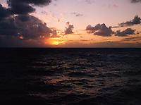 Sky at dusk, showing a litle orange on the horizon over the sea. Lautoka, Fiji Islands.