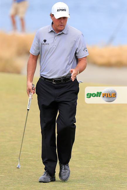 Phil MICKELSON (USA) putts on the 15th green during Thursday's Round 1 of the 2015 U.S. Open 115th National Championship held at Chambers Bay, Seattle, Washington, USA. 6/18/2015.<br /> Picture: Golffile | Eoin Clarke<br /> <br /> <br /> <br /> <br /> All photo usage must carry mandatory copyright credit (&copy; Golffile | Eoin Clarke)