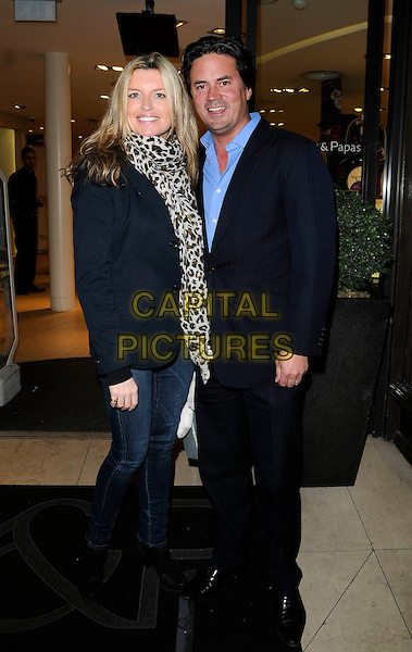 TINA HOBLEY & OLI WHEELER  .At the Mamas & Papas 30th Anniversary Party, Mamas & Papas store, Regent Street, London, England, UK, .March 7th 2011..full length leopard print brown animal scarf black jacket blazer jeans suit blue shirt husband wife couple .CAP/CAN.©Can Nguyen/Capital Pictures.