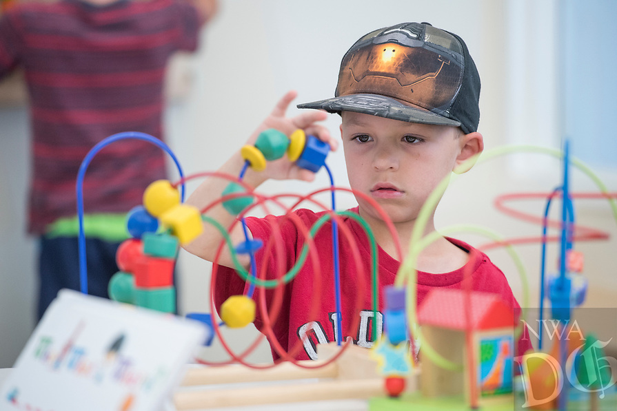 NWA Democrat-Gazette/J.T. WAMPLER Caleb McHaney, 6, plays Wednesday July 5, 2017 at the Siloam Springs Public Library. Saturday July 8th is the last day to sign up for the Summer Reading Incentiver Program for children ages 3-18. For more information about activities at the library call 479-524-4236.