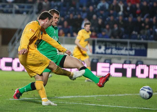 Scott McDonald rounds keeper Robert Olejnik to score goal no 3 for Celtic