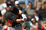 Giants' Ryan Theriot gets a hit during a Cactus League preseason game between the San Francisco Giants and the Arizona Diamondbacks in Scottsdale, Ariz., on Sunday, March 4, 2012. The Giants won 11-1..Photo by Cathleen Allison