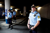 Oslo, Norway, 25.07.2011. Police forces guarding one of the five entrances to the garage at the court house. Anders B. Breivik is due to arrive at the Oslo courthouse at 13:00. The aquare around and in front of the building is packed with foreign media. Breivik arrived and left in an armored car escorted by armed police. He is to be imprisoned for eight weeks, awaiting further investigation of the massacre and bopmb attack in Oslo and Utøya. Foto: Christopher Olssøn.