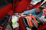 Malinda Word daily cleans out rubbish in her SUV where her husband, Jack, and their three children ,Teyerah,12, Jack,7, and Trynique,3,slept for three months before finding a homeless shelter in Portland recently.