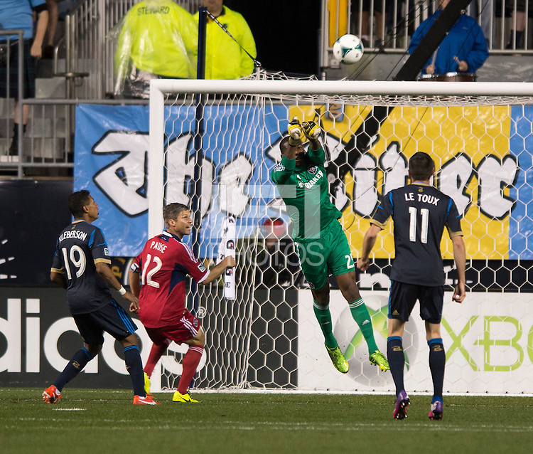 Sean Johnson (25) of the Chicago Fire punches the ball during a Major League Soccer match at PPL Park in Chester, PA.  Philadelphia defeated Chicago, 1-0.