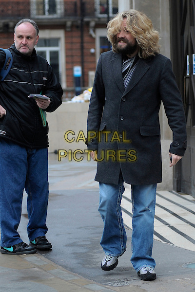 JUSTIN LEE COLLINS .At Broadcasting House, London, England, UK, .January 22nd 2011..full length jeans grey gray coat hair beard facial .CAP/DYL.©Dylan/Capital Pictures.
