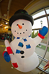Garden City, New York, USA. December 1, 2013. A large inflatable snowman was one of a wide variety of decorations at the Winter holiday Festival of Trees. Event proceeds benefited United Cerebral Palsy Association of Nassau County, Long Island.