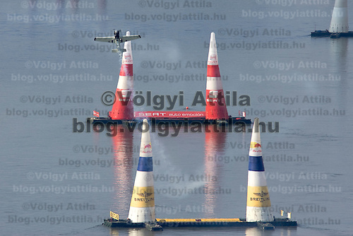 0708185357a Red Bull Air Race international air show practice runs over the river Danube, Budapest preceding the anniversary of Hungarian state foundation. Hungary. Saturday, 18. August 2007. ATTILA VOLGYI
