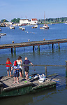 AT5CH0 Family fishing for crabs on a wooden jetty River Deben Woodbridge Suffolk England