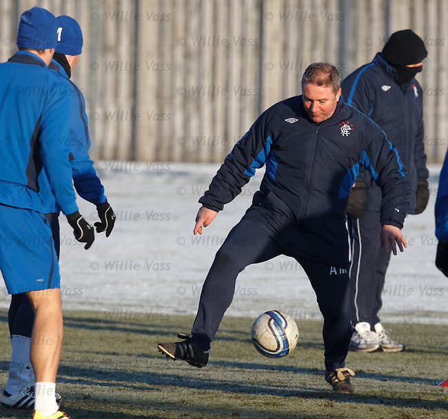 Ally McCoist stretches for the ball but is about to take a tumble on the icy surface