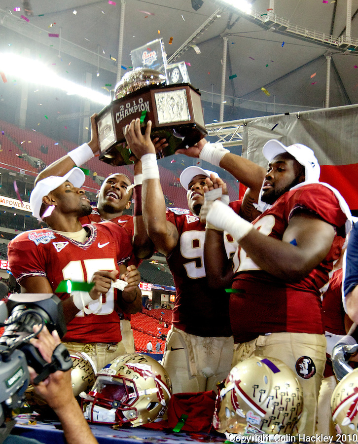 ATLANTA, AG 12/31/10-FSU-SC FB10 CH-Florida State's Ochuko Jenije, left, EJ Manuel, Markus White and Rodney Hudson celebrate beating South Carolina 26-17 at the Chick-fil-A Bowl in Atlanta. .COLIN HACKLEY PHOTO
