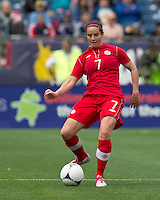 Canadian defender  Rhian Wilkinson (7) passes the ball. In an international friendly, Canada defeated Brasil, 2-1, at Gillette Stadium on March 24, 2012.