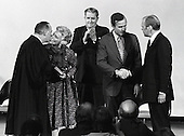 United States President Gerald R. Ford shakes hands with George H.W. Bush, who was sworn-in as Director of the Central Intelligence Agency (CIA) at the agency's headquarters in Langley, Virginia on January 30, 1976.  From left to right: Associate Justice of the U.S. Supreme Court Potter Stewart; Barbara Bush; Vernon Walters, Deputy Director of the CIA; Director Bush; President Ford.<br /> Credit: Barry Soorenko / CNP