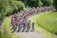 peloton over le &quot;Petit Poggio&quot;  with Team OmegaPharma-QuickStep closing the door and preventing other riders to pass<br /> <br /> 2014 Belgium Tour<br /> stage 4: Lacs de l'Eau d'Heure - Lacs de l'Eau d'Heure (178km)