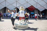 MOSCOW, RUSSIA - June 16, 2018: An Argentina fan poses with Zabivaka, the mascot for the 2018 FIFA World Cup before the Iceland vs. Argentina game at the 2018 FIFA World Cup.