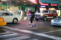 3 July 2005 - New York City, NY, USA - A rider crosses Times Square across traffic paths to reach an alleycat checkpoint on 43rd street in New York City, USA, July 3rd 2005. Alleycats are urban cycle races held informally - without notification of the authorities - on open roads and in real traffic, to simulate the messenger's working conditions. Photo Credit: David Brabyn<br />